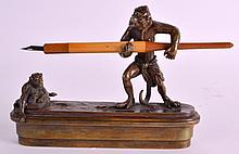 A RARE EARLY 20TH CENTURY AUSTRIAN COLD PAINTED BRONZE DESK SET modelled as a monkey holding a pen, the other opening to reveal an inkwell. 5.75ins wide.