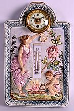 A RARE 19TH CENTURY AUSTRIAN MAJOLICA CLOCK with central gilt cased dial, decorated in relief with two classical figures. 14Ins x 9.5ins