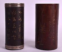 A 19TH CENTURY CHINESE CARVED BAMBOO BRUSH POT incised with calligraphy, together with another lacquered brush pot. 5.25ins & 5ins high. (2)