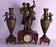 AN ART NOUVEAU COLD PAINTED SPELTER CLOCK GARNITURE with red marble, overlaid with foliage and vines. Clock 1ft 10ins high.