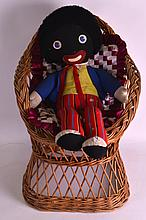 A PLUSH GOLLY TOY together with a wicker childs chair. (2)