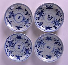 A SET OF FOUR 18TH CENTURY CHINESE CA MAU CARGO SAUCERS painted with floral sprays. 4.75ins diameter. (4)