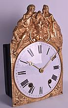A MID 19TH CENTURY FRENCH HANGING WALL CLOCK with sheet brass embossed mounts, depicting figures playing instruments, encasing a circular dial with painted numerals. 8Ins x 12ins.