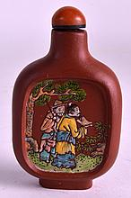 A 19TH CENTURY CHINESE YIXING POTTERY SNUFF BOTTLE AND STOPPER painted with a scholar and deer within a landscape. 2.75ins high.
