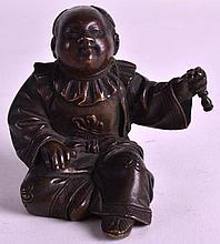 A 19TH CENTURY JAPANESE MEIJI PERIOD BRONZE FIGURE OF A CHILD modelled holding utensil within his hand. 2.75ins high.