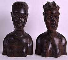 A PAIR OF AFRICAN CARVED HARDWOOD BUSTS. 7.5ins high.