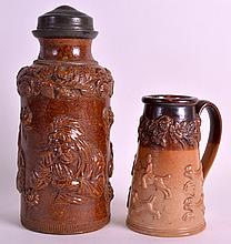 A 19TH CENTURY ENGLISH STONEWARE TOBACCO JAR together with a smaller stoneware shaving mug. 9Ins & 5.5ins high. (2)
