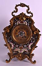 A LOVELY 19TH CENTURY FRENCH ORMOLU AND CHAMPLEVE ENAMEL MANTEL CLOCK of rococo form, decorated with scrolling foliage. 10Ins high inc handle.