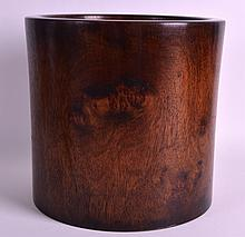 A LARGE CHINESE CARVED HARDWOOD BRUSH POT Bitong, Late Qing/Republic, of cylindrical flared form. 9Ins high.