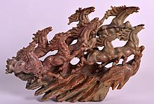 AN EARLY 20TH CENTURY CHINESE CARVED SOAPSTONE GROUP depicting the eight horses of Wang Mu. 10.5ins wide.