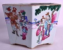 A MID 19TH CENTURY CHINESE FAMILLE ROSE HEXAGONAL JARDINIERE Daoguang, painted with figures within a landscape. 10Ins wide.