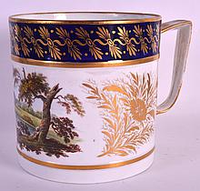 AN EARLY 19TH CENTURY DERBY PORTER MUG painted with a landscape, gilded with floral sprays between cobalt blue and gilt. 5.5ins high.
