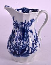 A FINE 18TH CENTURY WORCESTER FACETTED CREAM JUG painted with holed rock and leafy shrub. 4Ins high.