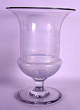 A LARGE FRENCH CLEAR GLASS PEDESTAL CHAMPAGNE BUCKET. 11.5ins high.