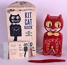 A BOXED 1980S NOVELTY KITCHEN CLOCK advertising Kit Cat chocolate. 7.5ins long.