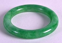 A CHINESE GREEN JADEITE CHILDS BANGLE 20th century. 2Ins diameter.