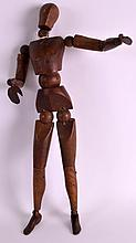 A 19TH CENTURY EUROPEAN ARTICULATED ARTISTS DOLL with moving joints. 1ft 2ins high.