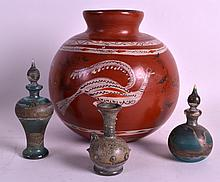 A 19TH CENTURY GRAND TOUR ROMAN STYLE GLASS VESSEL together with two other similar bottles & a South American jar. (4)