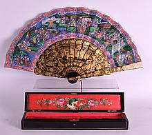 AN EXTREMELY FINE 19TH CENTURY CHINESE BLACK LACQUER AND IVORY FAN contained within a fitted case painted with birds, the fan with ivory portraits, depicting figures in various pursuits. 1ft 9ins extended.