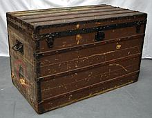A GOOD LARGE EARLY 20TH CENTURY LOUIS VUITTON TRAVELLING TRUNK No. 33450, with iron mounts and brass studwork decoration, various travelling labels. 3ft 8ins x 2ft 3ins.