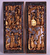 A PAIR OF EARLY 20TH CENTURY CHINESE GILTWOOD TEMPLE PANELS carved with figures. 12.5ins x 5ins.