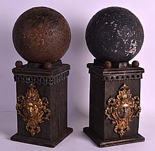 A GOOD PAIR OF 12LB CANNON BALLS recovered from the Battle Of Alma (Crimea) upon carved wood bases with bronze mounts. Each ball 6.5ins diameter.