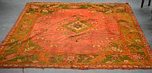 A LARGE PERSIAN ORANGE GROUND CARPET decorated with leaves and floral motifs. 9Ft 4ins x 9ft.