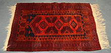 A PERSIAN ORANGE AND RED GROUND RUG. 4Ft x 2ft 9ins.