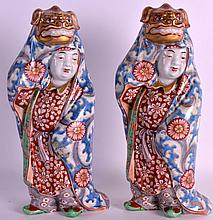 A PAIR OF 19TH CENTURY JAPANESE MEIJI PERIOD AO KUTANI FIGURES depicting children within carnival robes. 11Ins high.