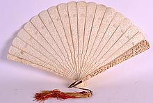 A 19TH CENTURY CHINESE CARVED CANTON IVORY FAN finely formed with pierced panels of figures within landscapes, with attachd white hetian jade toggle. 1ft 1ins extended.