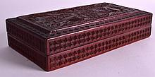 A 19TH CENTURY CHINESE CARVED CINNABAR LACQUER RECTANGULAR BOX AND COVER depicting figures within landscapes. 10ins x 5.5ins.