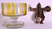 A BOHEMIAN CLEAR AND YELLOW GLASS BOWL together with a brass dish in the form of a male. (2)