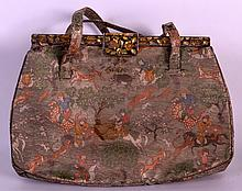 AN EARLY 20TH CENTURY PERSIAN WOVEN SILK LADIES HANDBAG with silver and gold mounts. 8.5ins wide.