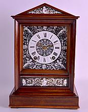A GOOD LATE 19TH CENTRY MAHOGANY BRACKET CLOCK by Winterhalter & Hoffmeir, unusually inset with an enamel dial and matching panels, decorated with putti amongst flowing vines. 1ft 0.5ins high.
