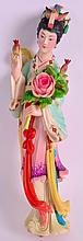 A FINE EARLY 20TH CENTURY CHINESE POLYCHROMED IVORY FIGURE OF A FEMALE modelled holding a fruiting pod and flowers. 9.5ins high.