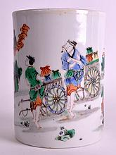 A FINE 17TH CENTURY CHINESE FAMILLE VERTE BRUSH POT C1680 painted with figures and a tradesman within a landscape. 6.25ins high.