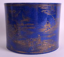 A 19TH CENTURY CHINESE POWDER BLUE BRUSH POT Qing, highlighted in gilt with figures on a boat upon a river. 7Ins wide.