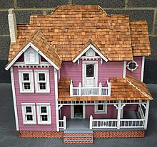A LARGE PAINTED CHILDS DOLLS HOUSE together with various accessories and furniture. 3Ft x 2ft 5ins.