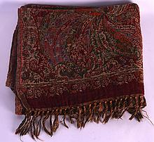 AN EARLY 20TH CENTURY KASHMIR SHAWL decorated with foliage.