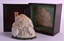 A FINE CHINESE CARVED WHITE JADE MOUNTAIN GROUP probably late qing, supported on a spinach jade base within a fitted collectors box. 4ins x 4ins.