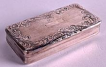 A SMALL MID 19TH CENTURY SILVER RECTANGULAR PILL BOX engraved with flowers. 2.25ins wide.