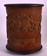 A CHINESE CARVED BAMBOO BRUSH POT Bitong, Late Qing/Republic, decorated with scholars within a landscape. 6.75ins high.