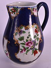 A FINE 18TH CENTURY WORCESTER BLUE SCALE SPARROWBEAK JUG painted with flowers in a mirror cartouche. 5.25ins high.