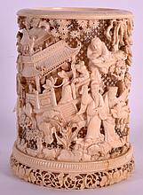 A 19TH CENTURY CHINESE CARVED IVORY BRUSH POT of cylindrical form, well decorated with figures within landscapes. 264 grams. 5.5ins high.