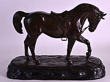 A 19TH CENTURY JAPANESE MEIJI PERIOD BRONZE FIGURE OF A ROAMING HORSE by Masao, modelled with its front leg raised, inscribed extensively to the underside. 1ft 1ins wide.