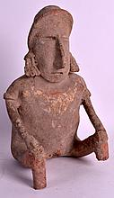 A PRE COLUMBIAN POTTERY FIGURE OF A MALE modelled holding both knees. 10.5ins high.