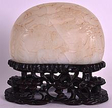 A GOOD 18TH/19TH CENTURY CHINESE WHITE JADE PANEL hollow carved with two figures within a landscape, upon a well carved hardwood base. Jade 5.5ins x 3.75ins.