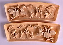 A PAIR OF EARLY 20TH CENTURY CHINESE CANTON CARVED IVORY WRIST RESTS Qing/Republic, depicting figures within landscapes. 6.5ins wide.