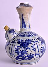 A 17TH CENTURY CHINESE BLUE AND WHITE KENDI painted with scattered flowers and motifs. 8.5ins high.