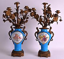 A PAIR OF 19TH CENTURY FRENCH SEVRES PORCELAIN VASES converted to candleabra, painted with putti within panels, mounted in French ormolu. 1ft 8ins high.
